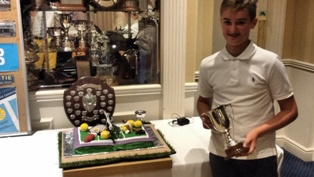 Kyle and the cake (made by Fiona Dunlop and  decorated by Karen Gorman)